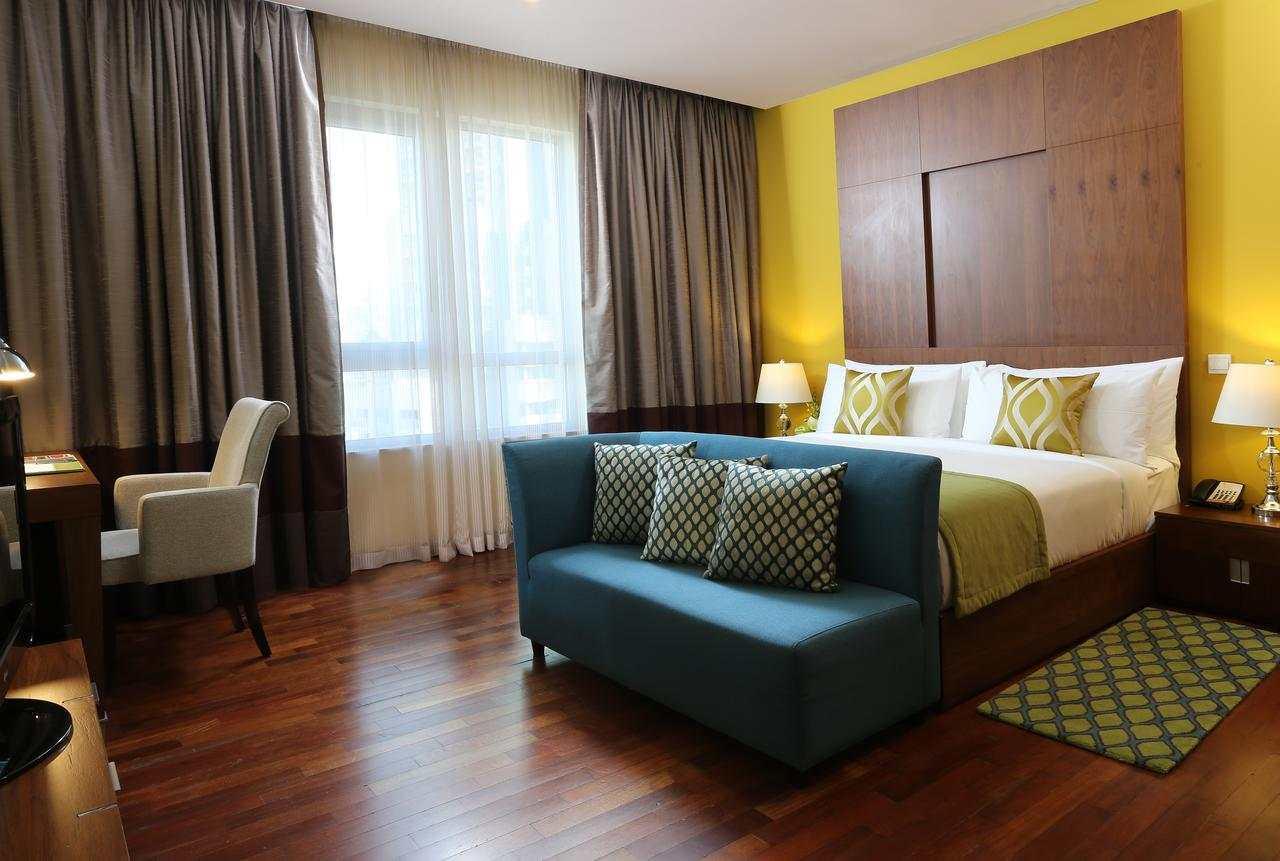 تتميز غرف فندق رامادا داون تاون دبي بمساحاتها الواسعة ونظافتها.