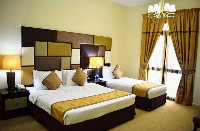 يشتمل الوليد بالاس للشقق الفندقية عود ميثاء على غرف مٌرتبة