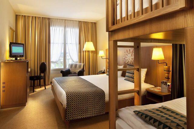 تتميّز حجرات فندق دريم كاسل ديزني لاند باريس بطراز بديع مُستمد من طراز الفرسان وقعة بوتسدام.