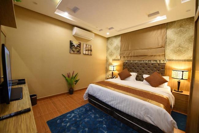 غُرفة فخمة وأسّرة مُريحة في افضل الشقق في الرياض