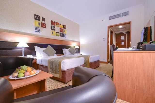 غرف فندق الانصار جولدن توليب المدينة تتمتع بالمزايا القياسية أضف إليها الديكورات الكلاسيكية الأنيقة