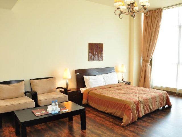 فخامة الغرف القياسية في فندق المنزل بالبحرين الشهير في المنامة
