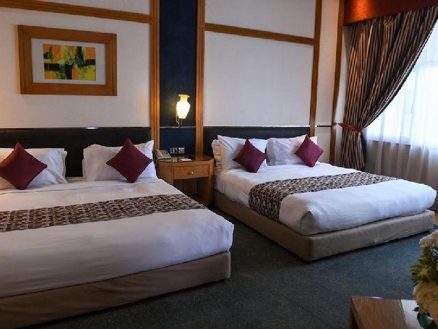 غرفة مزدوجة تتسع لأربعة أشخاص في فندق الجفير جراند