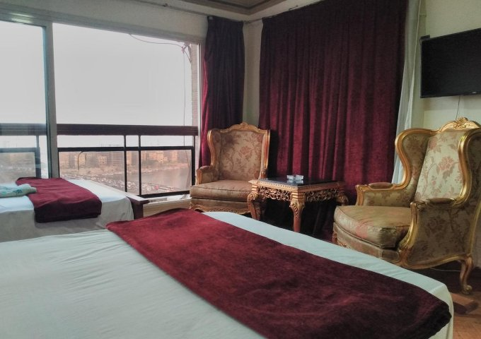 غرفة بفندق نايل ستار شقق فندقيه القاهره